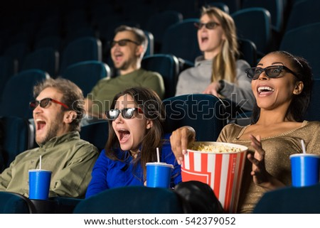 3D reality. People wearing 3D glasses screaming while watching a movie at the local cinema weekend premiere 3D technology shocked surprised scream entertainment activity concept