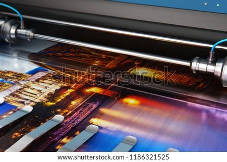 3D render illustration of printing photo banner on large format color plotter in typography or print house printshop Stock photo ©