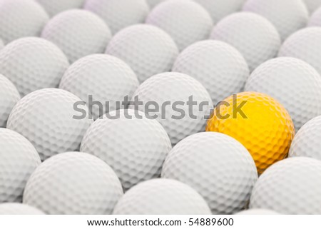 3d render of golf balls with colored one to the side