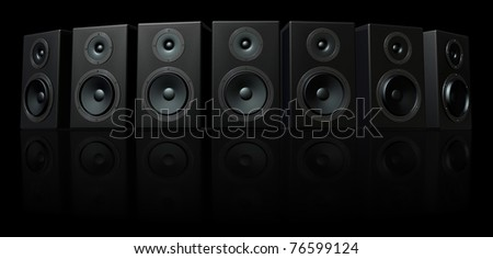 3D Render of loud speakers on a black reflective background - stock photo