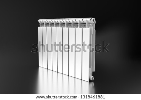 3D rendering. Central heating radiator with many sections. White heating radiator on black background. #1318461881