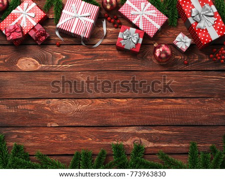 3D rendering dark christmas wooden background with branches of spruce, holly berries, ornaments and gifts