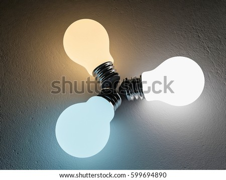 3D rendering image of 3 light bulb or lamps place on the cracked concrete floor. Night scenc perspective. Color temperature scale. Cool white,warm white, day light. different 3 colors of light effect