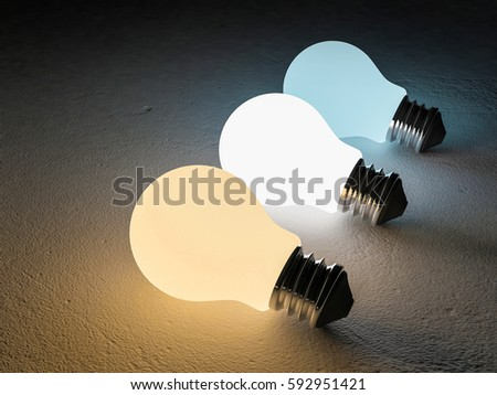 3D rendering image of 3 light bulb or lamps place on the cracked concrete floor. Night scene perspective. Color temperature scale. Cool white,warm white, day light. different 3 colors of light effect