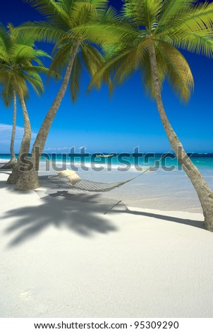 3D rendering of a hammock with cushions hanging from palm trees on a tropical beach