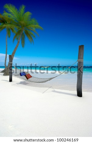 3D rendering of a hammock with cushions on a tropical beach