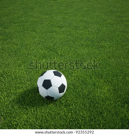 3d rendering of a soccerball lying on grass