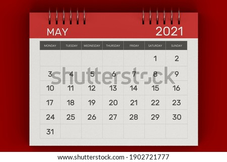 3d rendering of Business monthly calendar with metal spiral-bound, the week starts on Monday. Monthly Pages with red title, isolated on red background. English calendar for May 2021