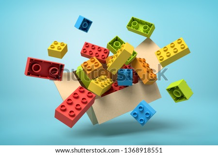 3d rendering of cardboard box in air full of colorful toy bricks which are flying out and floating outside on blue background. Children's goods. Toys and games. Toy manufacture. stock photo
