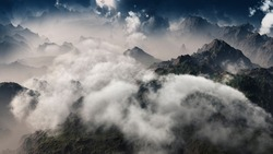 3d rendering of clouds over mountain range. Aerial view.