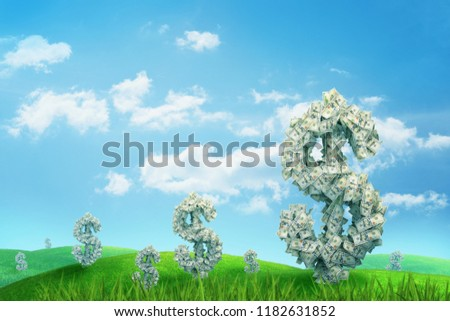 3d rendering of endless green field full of large dollar signs made of banknotes standing under blue sky. Money growth. Prosperity and wealth. Getting rich.