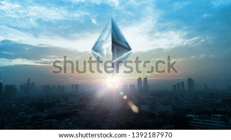 3D Rendering of Ethereum (ETH) coin on top of buildings in capital city during sun rise time. Concept of using blockchain technology to drive financial market