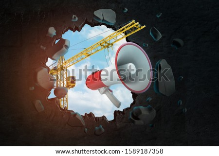 3d rendering of hoisting crane carrying megaphone and breaking hole in black wall with blue sky seen through. Construction industry. Large-scale building. Warnings and safety.