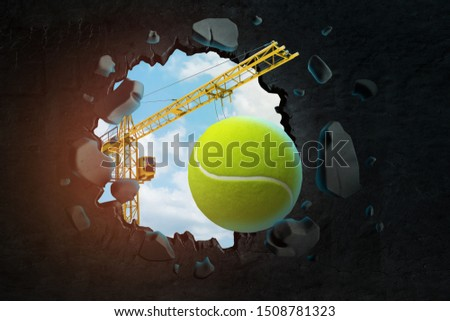 3d rendering of hoisting crane carrying tennis ball and breaking hole in black wall with blue sky seen through. Sports and games. Sporting equipment. Building tennis courts.