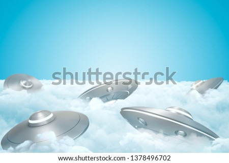 3d rendering of set of UFOs on thick layer of white fluffy clouds with blue sky above. Ufology theories. Cloud-cuckoo-land. Strange dreams.