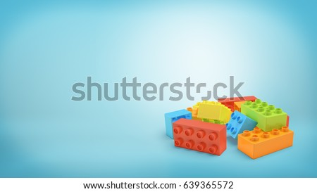 3d rendering of several multi-colored rectangular toy blocks lying in a pile on blue background. Games and toys. Building set. Different parts.