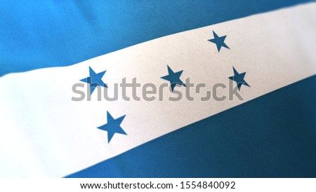 3D rendering of the national flag of Honduras waving in the wind. The banner/emblem is made of realistic satin texture and rendered in a daylight situation.