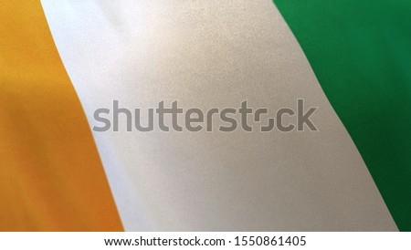3D rendering of the national flag of Ivory Coast waving in the wind. The banner/emblem is made of realistic satin texture and rendered in a daylight situation.