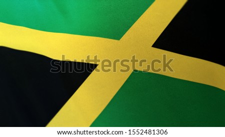 3D rendering of the national flag of Jamaica waving in the wind. The banner/emblem is made of realistic satin texture and rendered in a daylight situation.