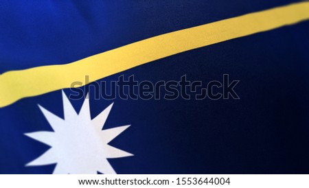 3D rendering of the national flag of Nauru waving in the wind. The banner/emblem is made of realistic satin texture and rendered in a daylight situation.