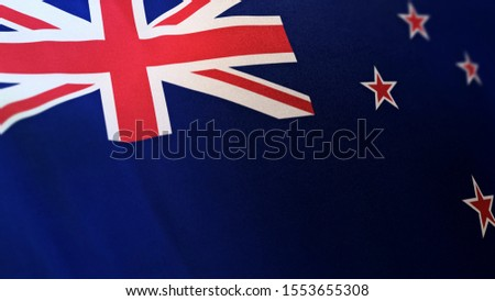 3D rendering of the national flag of New Zealand waving in the wind. The banner/emblem is made of realistic satin texture and rendered in a daylight situation.