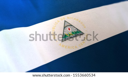 3D rendering of the national flag of Nicaragua waving in the wind. The banner/emblem is made of realistic satin texture and rendered in a daylight situation.