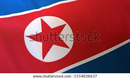 3D rendering of the national flag of North Korea waving in the wind. The banner/emblem is made of realistic satin texture and rendered in a daylight situation.