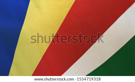 3D rendering of the national flag of Seychelles waving in the wind. The banner/emblem is made of realistic satin texture and rendered in a daylight situation.