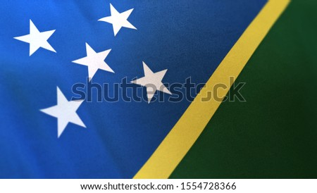 3D rendering of the national flag of Solomon Islands waving in the wind. The banner/emblem is made of realistic satin texture and rendered in a daylight situation.