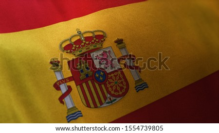 3D rendering of the national flag of Spain waving in the wind. The banner/emblem is made of realistic satin texture and rendered in a daylight situation.