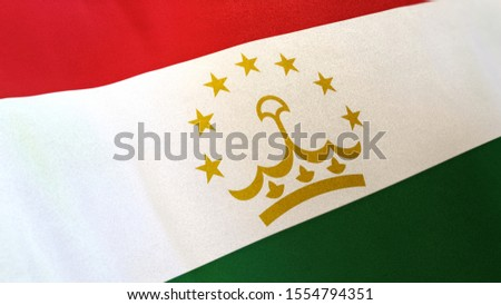 3D rendering of the national flag of Tajikistan waving in the wind. The banner/emblem is made of realistic satin texture and rendered in a daylight situation.
