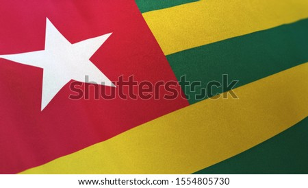 3D rendering of the national flag of Togo waving in the wind. The banner/emblem is made of realistic satin texture and rendered in a daylight situation.