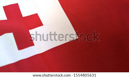 3D rendering of the national flag of Tonga waving in the wind. The banner/emblem is made of realistic satin texture and rendered in a daylight situation.