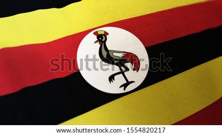 3D rendering of the national flag of Uganda waving in the wind. The banner/emblem is made of realistic satin texture and rendered in a daylight situation.