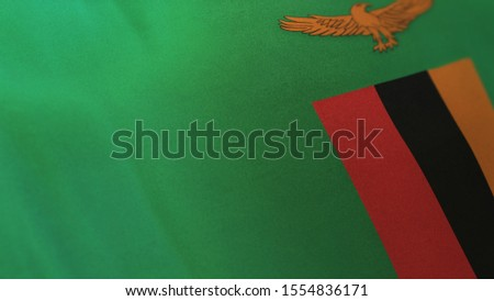 3D rendering of the national flag of Zambia waving in the wind. The banner/emblem is made of realistic satin texture and rendered in a daylight situation.
