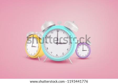 3d rendering of three retro pastel colored alarm clocks standing near each other on a pink background. Time and pleasure. Work or relaxation. Schedule pleasurable things.