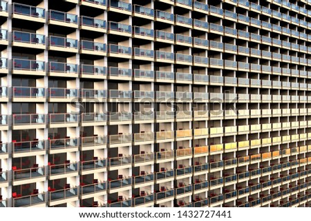3D rendering of uniformed looking apartments in a huge and overcrowded apartment building