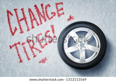 3d rendering of vehicle tire with red sign 'CHANGE TIRES' on grey background. Tires and wheels. Repairs and maintenance. Digital art.