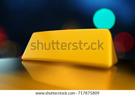 3d rendering Yellow taxi sign mock-up on the roof of car in a city street at night. Luminous neon taxi sign on bokeh big city background