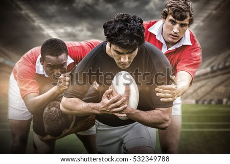 3D Rugby stadium against rugby players tackling during game