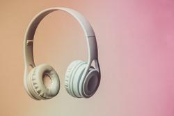 3D surround photo blue wireless headphones on gray background.