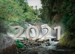 2021 3D text in twin waterfall photo inside the tropical rain forest. Bali Indonesia