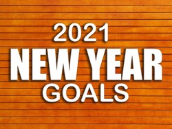 3D Text 2021 New Year Goals on wooden brown table. 3D rendered royalty free stock picture. This image can be used for an online website banner ad or a print postcard