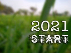 3D Text 2021 Start on blurred green natural background. 3D rendered royalty free stock picture. This image can be used for an online website banner ad or a print postcard. Copy Space for text