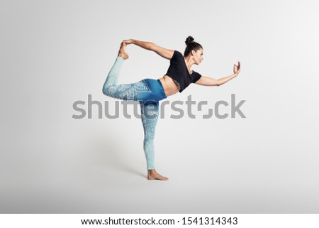 Dancer pose, yoga pose, woman on white background