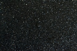 dark background in the form of a scattering of black and silver sequins