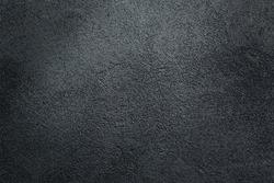 Dark textured asphalt black background.