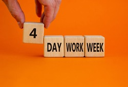 4 day work week symbol. Businessman holds the cube with words '4 day work week'. Beautiful orange background. Copy space. Business and 4 or 5 day work week concept.