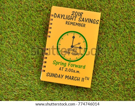 2018 Daylight Savings Remember clock turn ahead Spring Forward at 2:00 am Sunday March 11th on grass #774746014