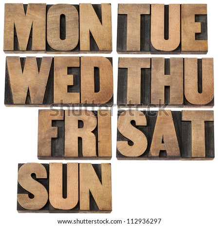 7 days of week (first 3 letter symbols) in isolated vintage wood letterpress printing blocks